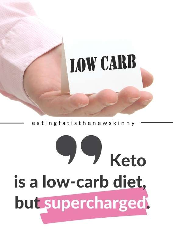 hand holding cardboard with 'low carb' print