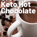 keto hot chocolate in a white mug with a wooden spoon pin