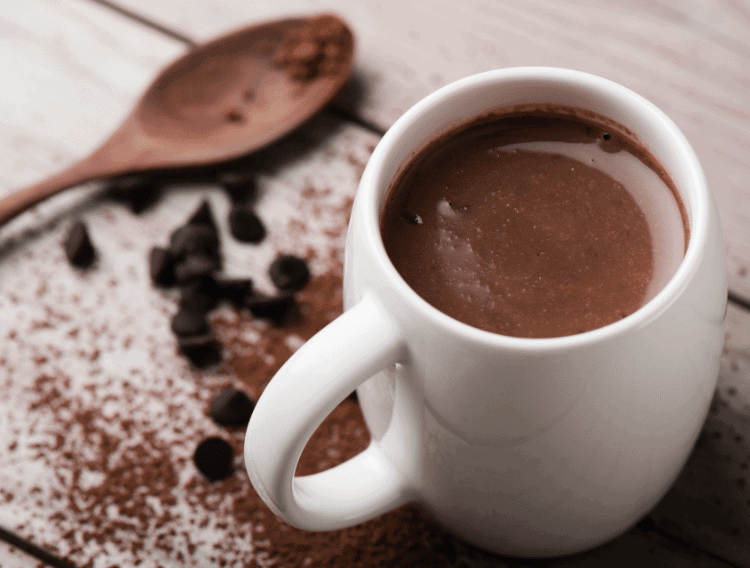 keto hot chocolate with a wooden spoon