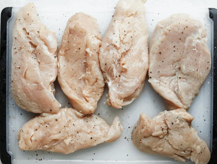 seasoned chicken breasts on a baking sheet