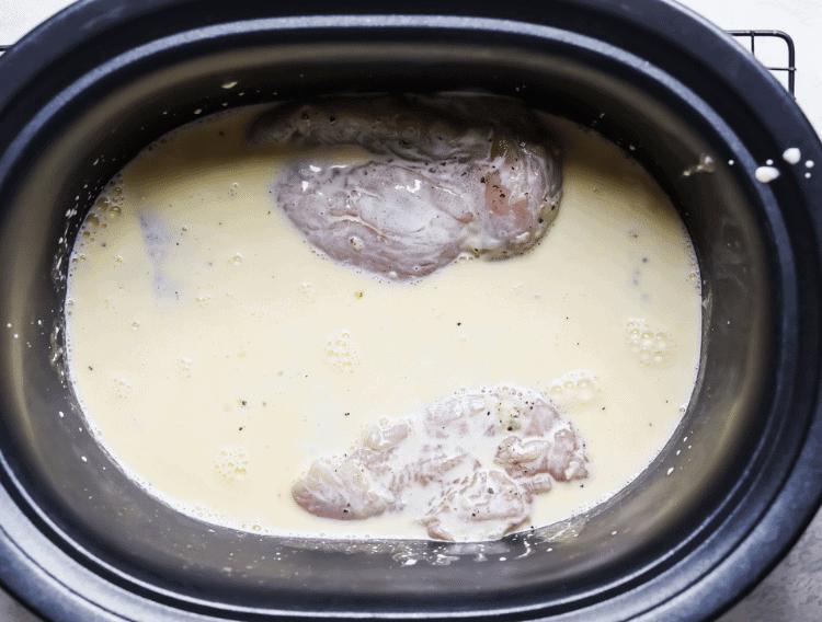 chicken in crockpot with creamy garlic keto sauce