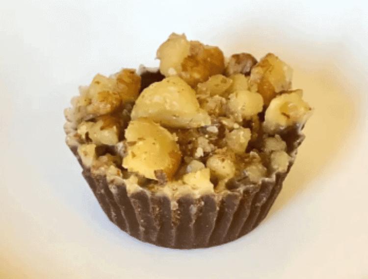 walnut fudge fat bombs on a white plate