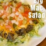 big mac salad with beef on a white plate