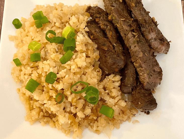 keto garlic steak strips with cauliflower fried rice