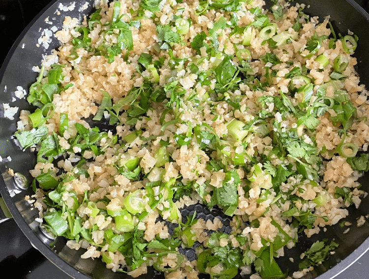 stir green onions and cilantro into fried rice