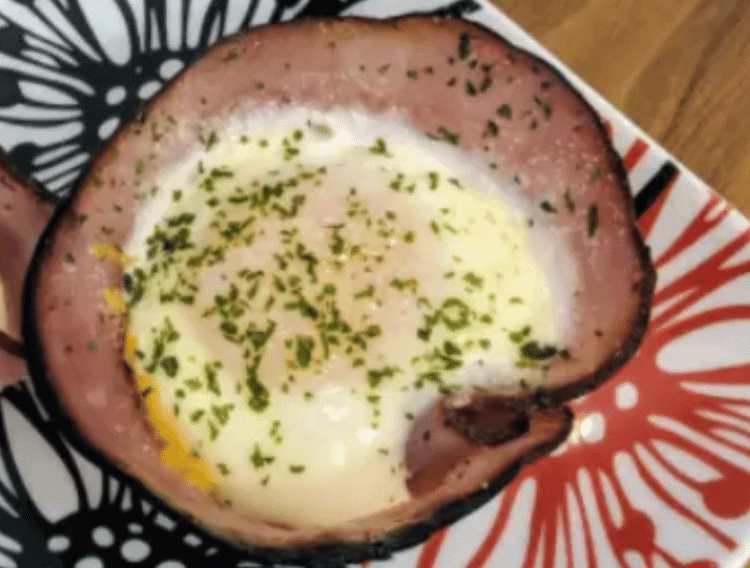 keto ham and egg cups on a flower plate