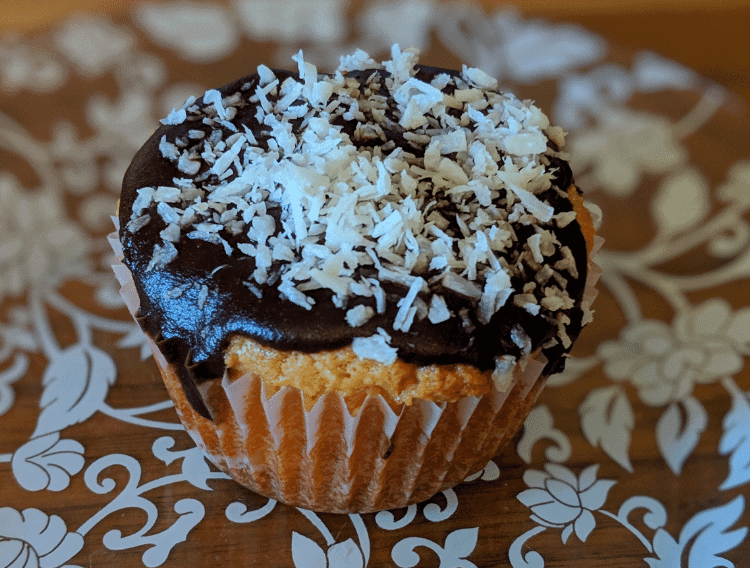 keto vanilla cupcakes with chocolate butter frosting on a dessert plate
