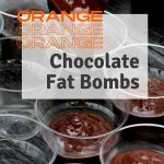 orange chocolate fat bomb mixture being transferred to transparent cups