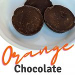 orange chocolate fat bombs on a white plate