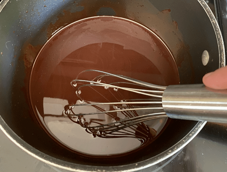 melted chocolate with whisk in a saucepan