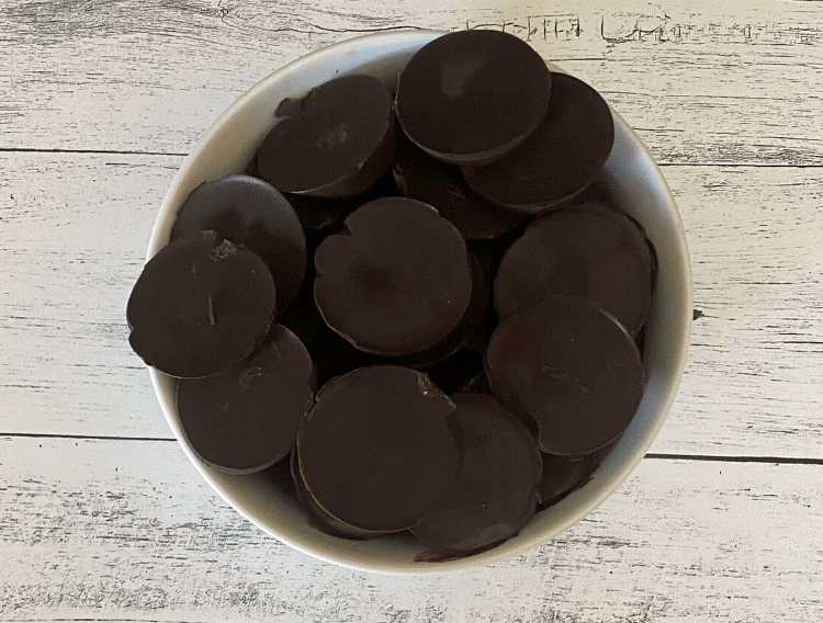 keto orange chocolate fat bombs in a white bowl on a rustic background