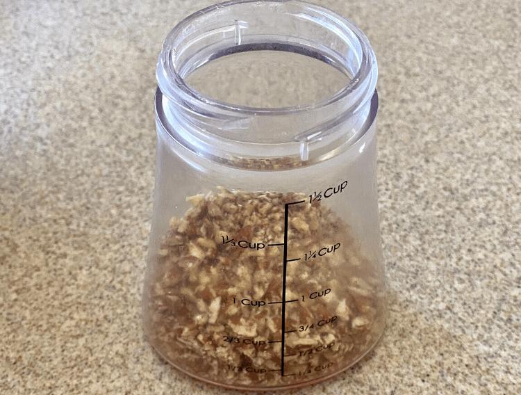 crushed pecans in a nut chopper