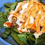 Buffalo Ranch Taco Salad on a blue plate