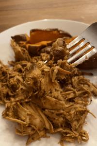 shredded Zesty Crockpot BBQ Chicken on a white plate