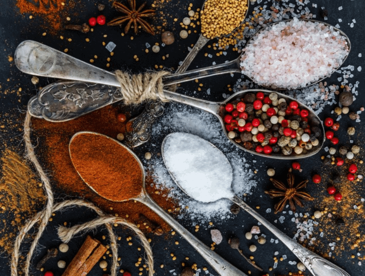 spices used in keto cooking in spoons