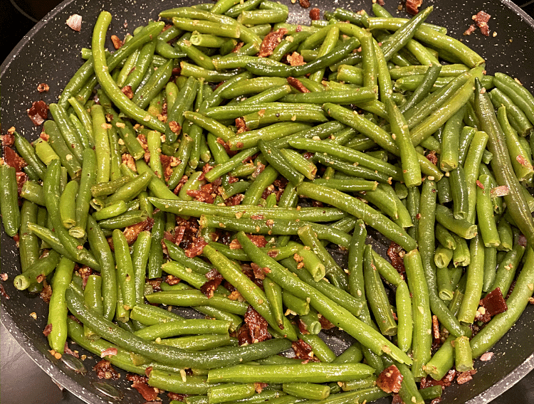 garlic bacon green beans in a large skillet