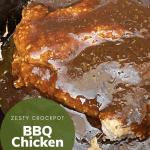 Zesty Crockpot Chicken with sauce on a black crockpot
