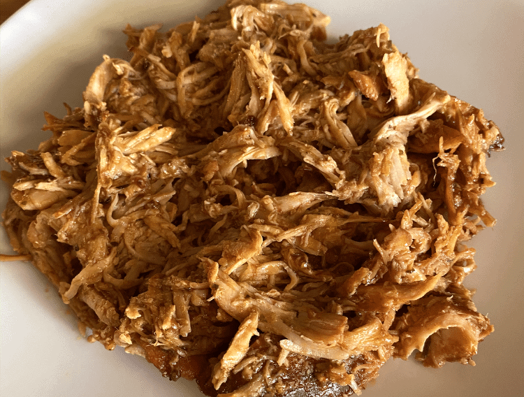 keto crockpot chicken thighs on a white plate