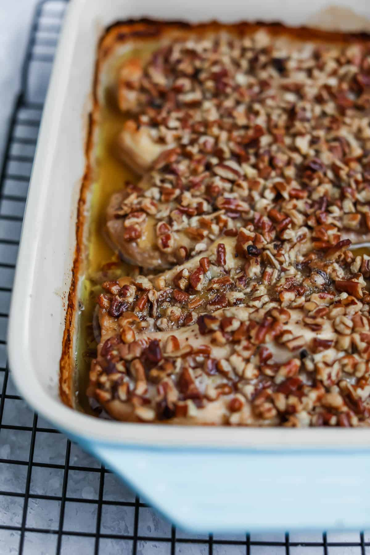 pecan crusted chicken in pan