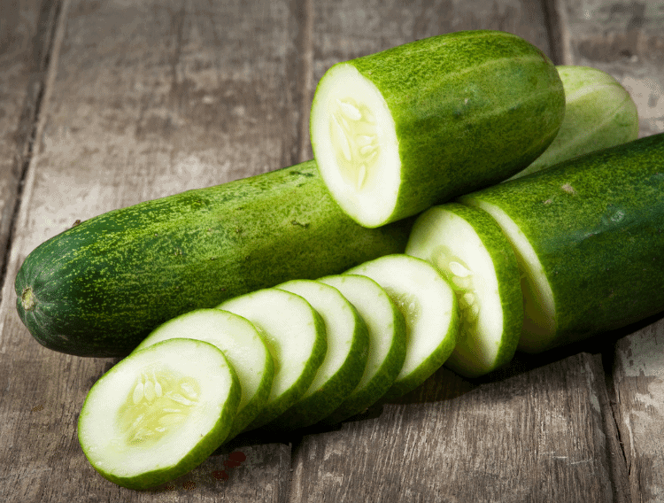 sliced cucumbers on a wooden board