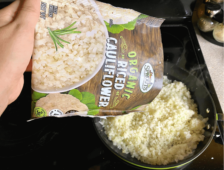 pouring riced cauliflower into pan
