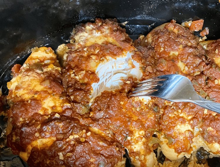 Keto Mexican shredded chicken in a crockpot with a fork